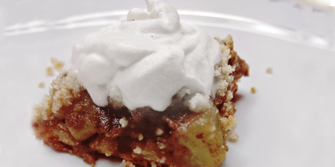 Keto Apple Pie Bars on a plate with whipped cream on top