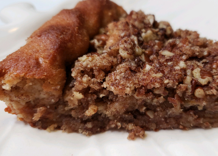 close up of a piece of pecan streusel coffee cake