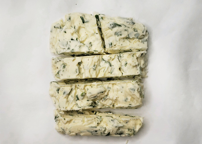 herbed butter cut into 4 strips