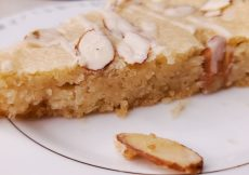 slice of bear claw cake with sliced almonds on top