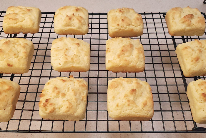 sour cream biscuits cooling on a cooling rack